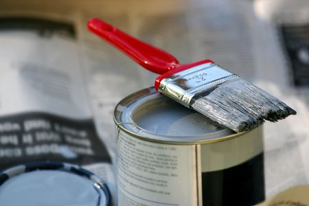 paintcan: a close up of a paint brush on a can of paint