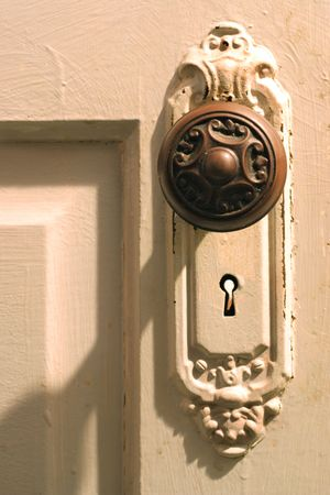a antique door knob on a panel door Stock Photo - 2818075