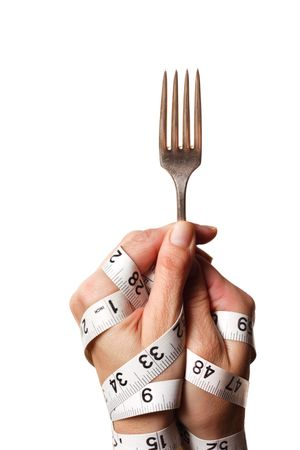 Hands holding a fork, tied together with measuring tape