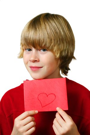 Young boy holds up an envelope with a heart drawn it Stock Photo - 2818073