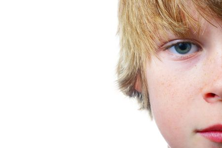 Closeup of half of a boy's face isolated on a white background with room for copy