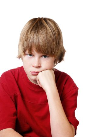 Boy sitting with his head on his hand looking annoyed