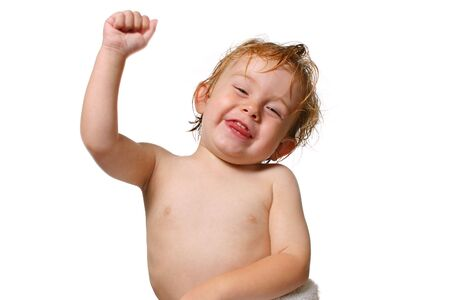 young boy smiling: Young boy smiling a holding his fist in the air
