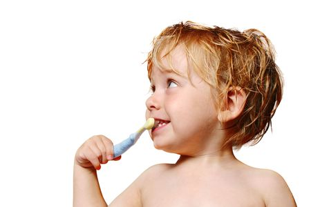 A happy young boy brushes his teeth Stock Photo - 2818057