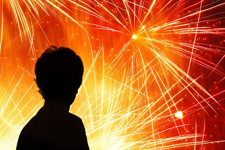firecracker: Silhouette of a child watching a fireworks display Stock Photo