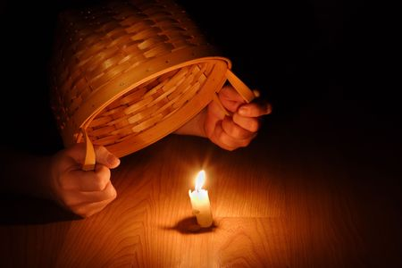 candle: Hands holding a basket over a burning candle
