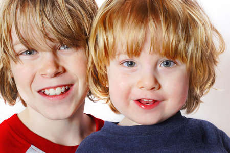 younger: a close up of a teenager and his younger brother Stock Photo