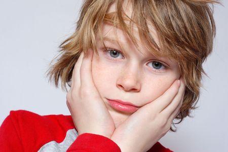 chłopięctwo: A chłopiec wygląda mylić i pewności Zdjęcie Seryjne