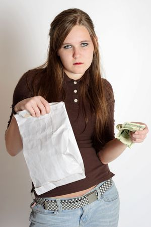 A young girl has a bag of fast food and a handful of money photo