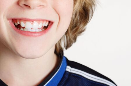 teenaged boy:  Close up of a teenaged boy smiling  Stock Photo
