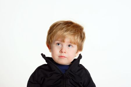Young boy thinking on a white background