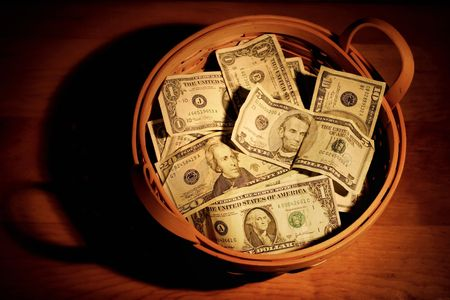 offering: A basket full of money with very dramatic lighting