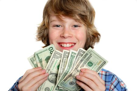 A teenaged boy holds a handful of American money
