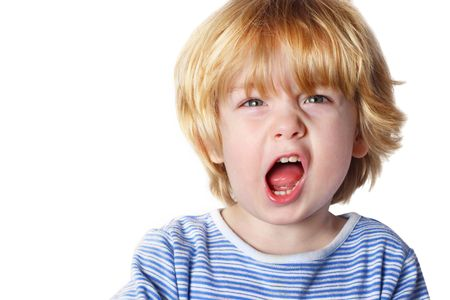 A toddler boy yelling on white background