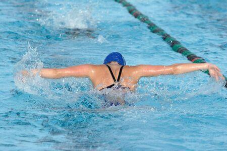 A swimmer does the  stroke in a race  Zdjęcie Seryjne