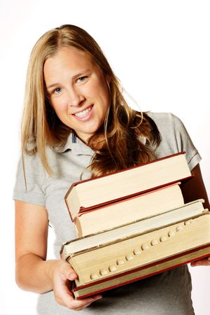 university admission: A teenage girl holding a pile of heavy books Stock Photo