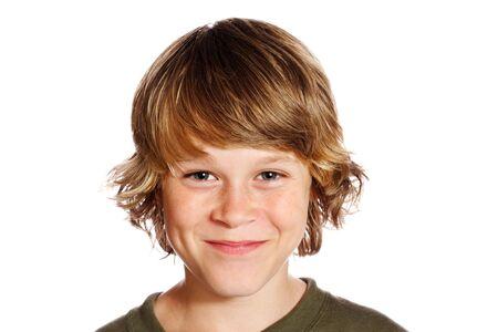 teenaged boy: A smiling teenaged boy isolated on white