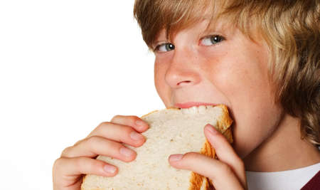 Teenager taking a bite out of a sandwich Stock Photo - 2863764
