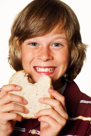 Teenager eating a peanut butter sandwich Stock Photo - 2863855