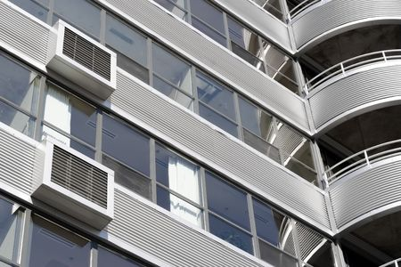 perspective grid: Close up of a modern building designed with a metal corregated facade