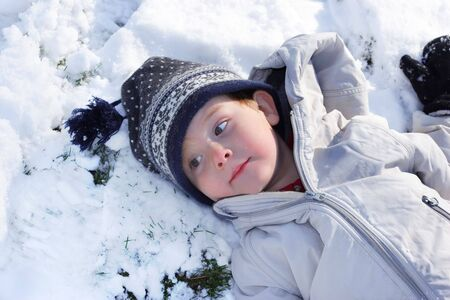 A young boy rests in the snow Stock Photo - 2863767