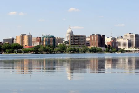 State of Wisconsin Capital as seen across lake Monona. Clear blue sky on a bright sunny day makes the city look very inviting