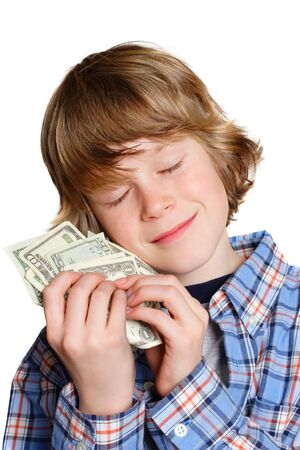 selfish: A boy hugging his money Stock Photo