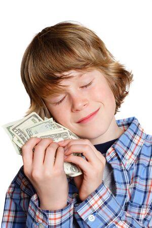 miser: A boy hugging his money Stock Photo
