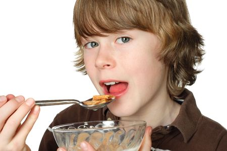 A teen boy ready to eat a spoonful of cereal Stock Photo - 2891315