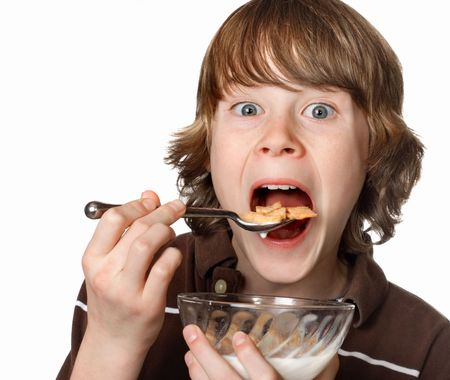 A boy opens his mouth wide for a spoonful of cereal Stock Photo - 2891282