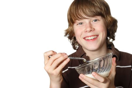 A smiling boy holds an almost empty bowl of milk and cereal Stock Photo - 2891247