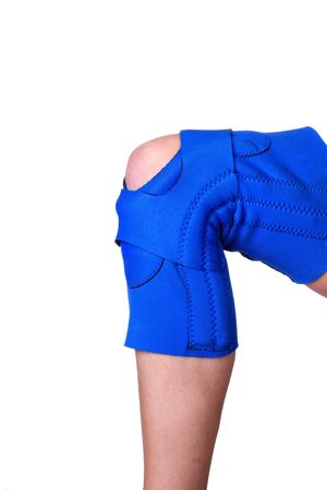 Isolated shot of a persons leg wearing a knee brace for protection Stock Photo - 2891294