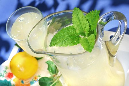 a pitcher of lemonade with a mint decoration Stock Photo