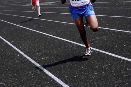 run down: A pair of runners run down the track Stock Photo