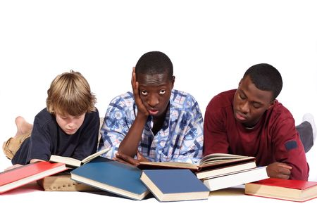 adolescence: Three boys studying piles of text books Stock Photo