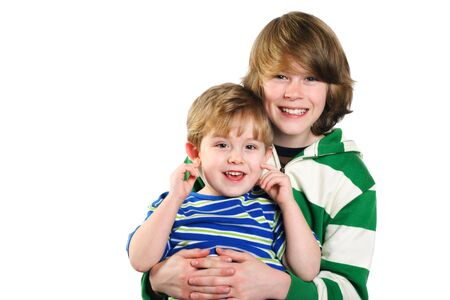 A teenager holds his younger brother on his lap Stock Photo - 2917259