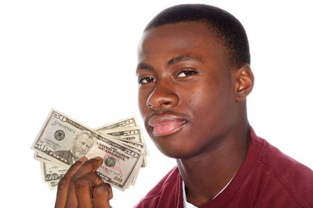 miser: a close up of a teenage boy holding a handfull of money Stock Photo