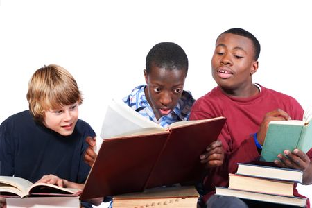 examination stress: Three boys studying are distracted from their work Stock Photo