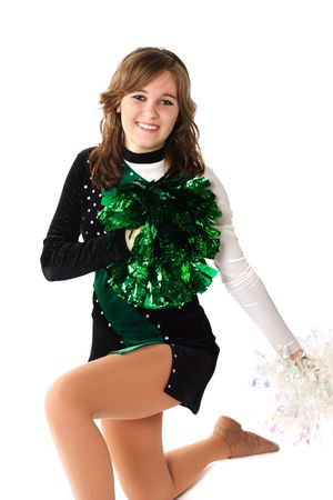 Happy young woman Kneeling on floor with pom pons Stock Photo