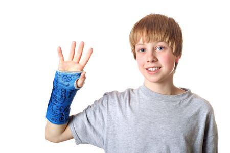 teenaged boy: Teenaged boy is happy that his cast is about to be removed