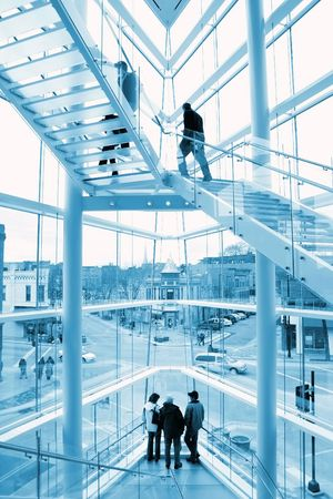 futuristic city: Interior of a modern glass building looking out on a historic street