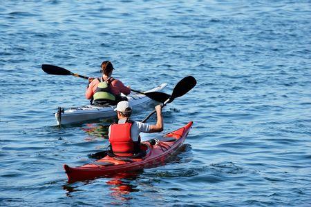 two kayacs on a calm blue lake Stock Photo