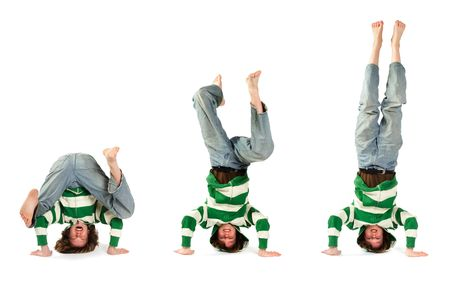 An adolescent attempting and succeeding at performing a headstand photo