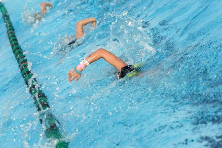 Several swimmers in a swim lane practicing laps photo