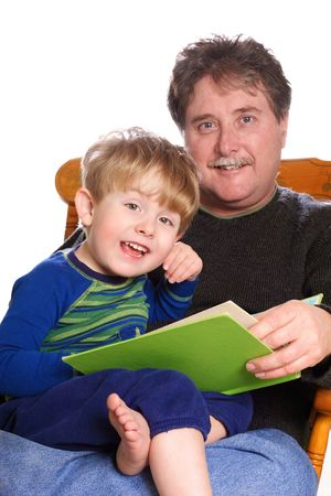 storytime: a father reads to his young son Stock Photo