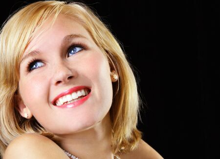 Close-up of a beautiful young woman on a black background Stock Photo - 3051348