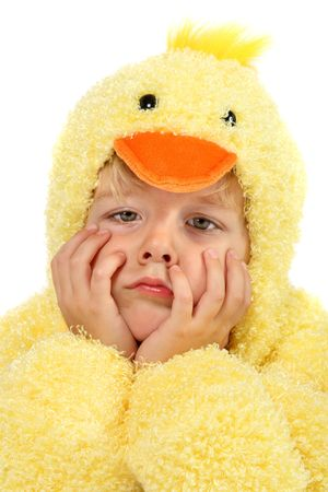 faced: Sad faced boy in a chicken suit Stock Photo
