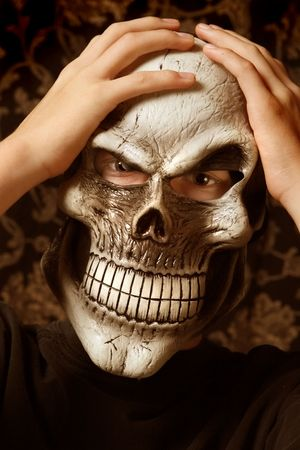 Teenage wearing a scary  mask photo