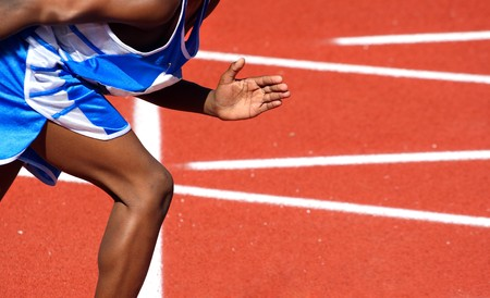 close-up of a person on a track starting to run a race Stock Photo