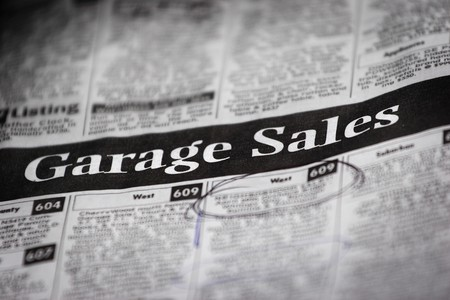 a newspaper with a garage sale heading (shallow depth of field) Stock Photo